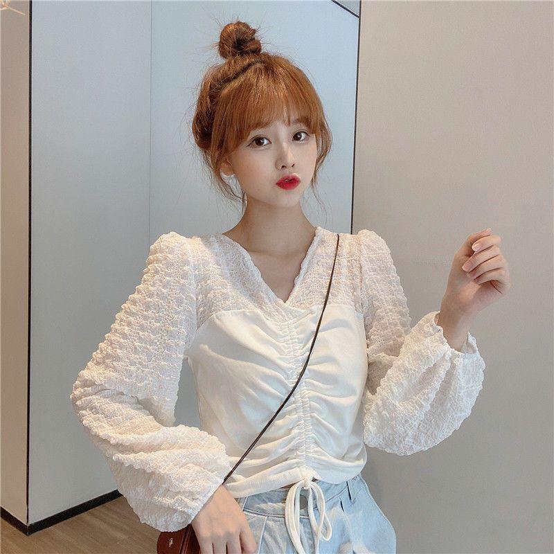 秋季新款2020韩版抽绳褶皱拼接白色针织衫女设计感泡泡长袖上衣潮