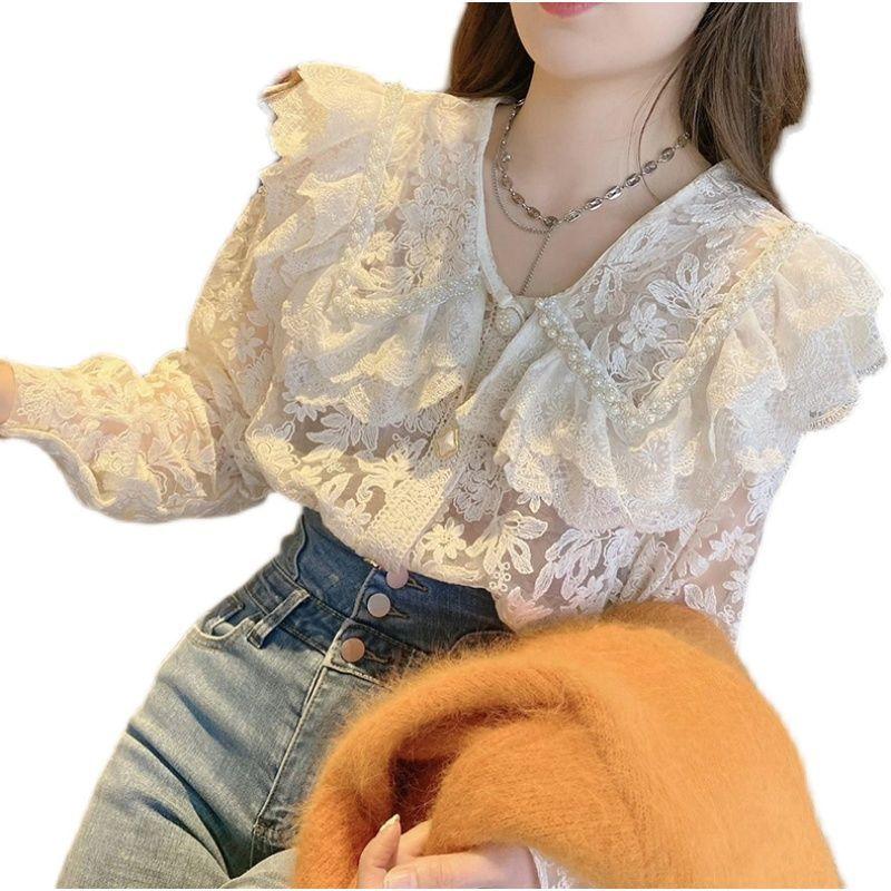 热卖新款钉珠重工娃娃领蕾丝衬衫女2021春装新款韩国洋气半透式仙