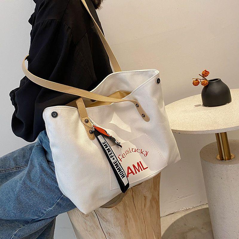 大容量包包女韩版网红手提袋子百搭ins日系少女帆布斜挎包女