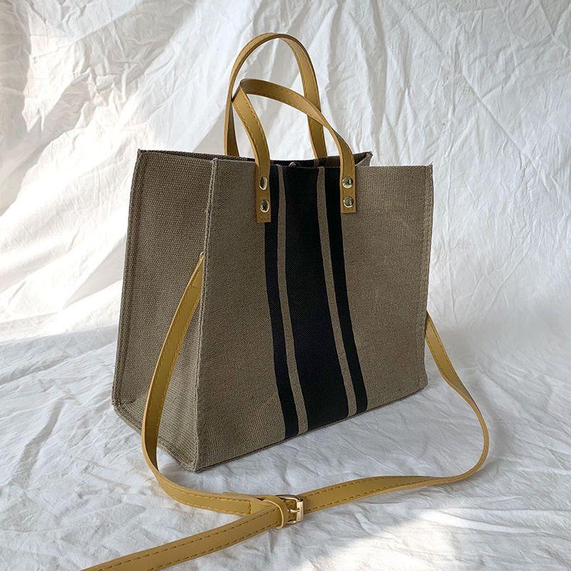 大容量质感包包女新款韩版ins手提公文包职业通勤条纹帆布包